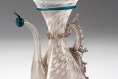 Brocchetta decorata a festoni e piume in lattino, inizi XVII sec.